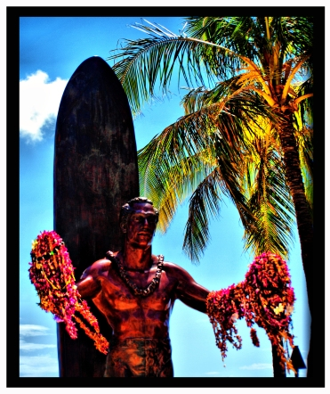 "On Kuhio Beach, a bronze statue of Duke Kahanamoku welcomes you to Waikiki with open arms. Duke was a true Hawaiian hero and one of the world's greatest watermen, a master of swimming, surfing and outrigger canoe paddling. Duke Paoa Kahanamoku was born on August 24, 1890. He grew up swimming and surfing in Waikiki near the current Hilton Hawaiian Village Waikiki Beach Resort. Discovered as a swimming sensation, Duke's legend began when he broke the world record in the 100-yard freestyle during his very first competition. The prodigious Duke went on to win Olympic gold in the 100-meter freestyle and silver in the relay in 1912. He also won two gold medals in 1920 and won a silver medal at age 34 in the 1924 Olympics. Duke was also one of the pioneers of the Waikiki Beach Boys, watermen who earned their livings teaching visitors how to surf and canoe at Waikiki Beach. If you look, you can still find real Waikiki Beach Boys showing visitors a great time in the Waikiki surf today. The amiable Duke also acted in Hollywood and used his fame to spread the popularity of surfing to the U.S. mainland and Australia. Later, he was elected Sheriff and official greeter of the city and county of Honolulu and was the first person to be inducted into both the Surfing Hall of Fame and the Swimming Hall of Fame. Duke Kahanamoku, ""The father of modern surfing,"" was Hawaii's first ambassador of goodwill. He was instrumental in helping to spread the sport of surfing and the spirit of aloha around the world."